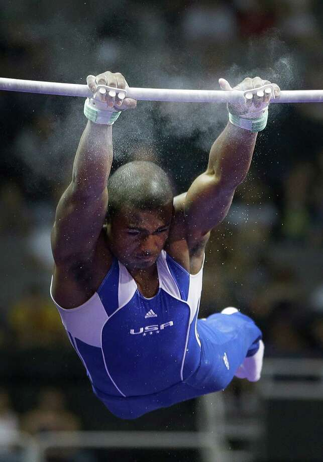 John Orozco finds his grip as he comes down on the horizontal bar during the preliminary round of the men's Olympic gymnastics trials Thursday, June 28, 2012, in San Jose, Calif. Photo: Jae C. Hong, Associated Press / AP