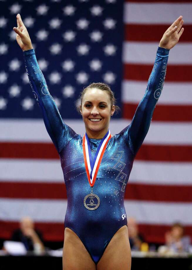 Savannah Vinsant celebrates during a medal ceremony after winning the women's trampoline finals at the U.S. Olympic gymnastics trials in San Jose, Calif., Wednesday, June 27, 2012. Photo: Jae C. Hong, Associated Press / AP