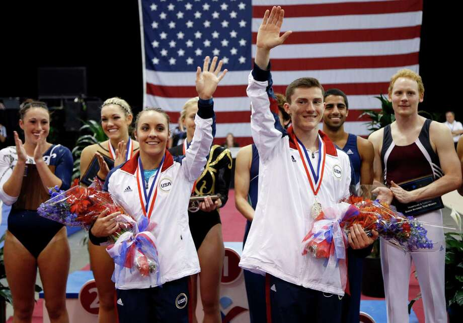 Steven Gluckstein, right, and Savannah Vinsant wave as they celebrate after winning the trampoline finals at the U.S. Olympic gymnastics trials in San Jose, Calif., Wednesday, June 27, 2012. Photo: Jae C. Hong, Associated Press / AP