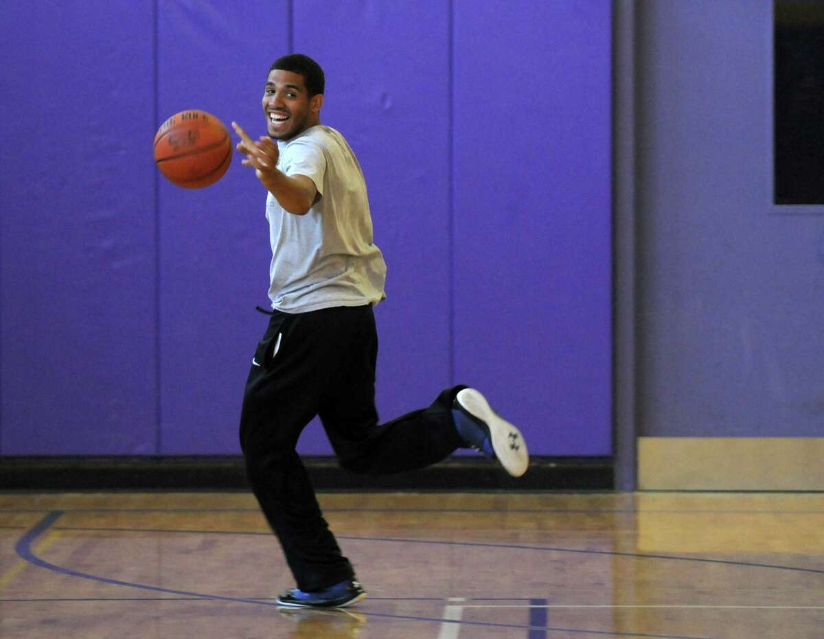 Talor Battle celebrates a game winning shot at the buzzer by a camper, during the Talor Battle Basketball Camp, sponsored by All Basketball Inc., at Troy High School on Thursday June 28, 2012 in Troy, NY. (Philip Kamrass / Times Union)