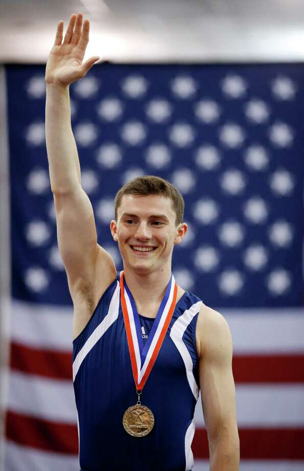Steven Gluckstein celebrates during a medal ceremony after winning the men's trampoline finals at the U.S. Olympic gymnastics trials in San Jose, Calif., Wednesday, June 27, 2012. Photo: Jae C. Hong, Associated Press / AP