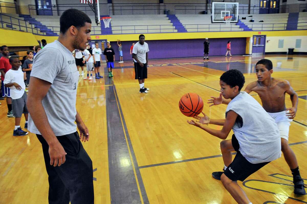 Talor Battle, left, watches campers play during the Talor Battle Basketball Camp, sponsored by All Basketball Inc., at Troy High School on Thursday June 28, 2012 in Troy, NY. (Philip Kamrass / Times Union)