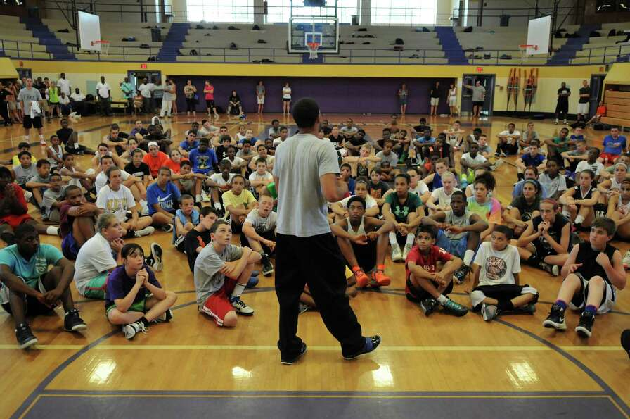 Talor Battle talks to campers at the end of the Talor Battle Basketball Camp, sponsored by All Baske