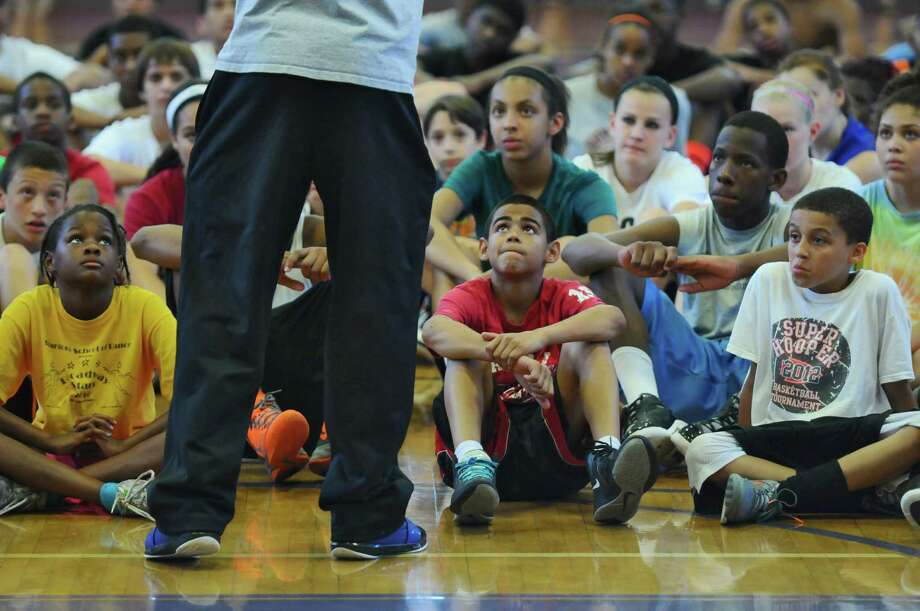 Talor Battle talks to campers at the end of the Talor Battle Basketball Camp, sponsored by All Basketball Inc., at Troy High School on Thursday June 28, 2012 in Troy, NY.  (Philip Kamrass / Times Union) Photo: Philip Kamrass / 00018282A