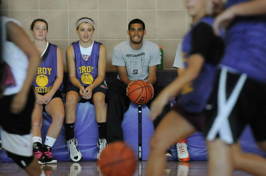 Talor Battle, center, watches a game between campers during the Talor Battle Basketball Camp, sponsored by All Basketball Inc., at Troy High School on Thursday June 28, 2012 in Troy, NY.  (Philip Kamrass / Times Union) Photo: Philip Kamrass / 00018282A