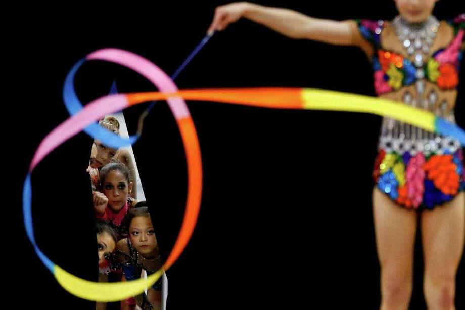Members of the junior national team watch Jazzy Kerber, foreground, compete during the rhythmic all-around finals at the USA Gymnastics Championships in San Jose, Calif., Wednesday, June 27, 2012. Photo: Jae C. Hong, Associated Press / AP