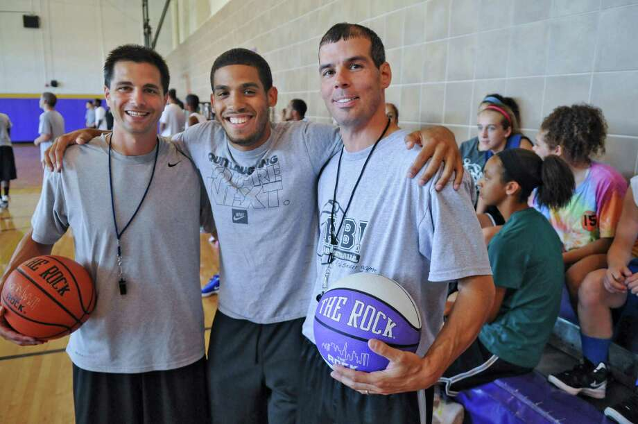 Mike Grasso, left, and Troy High School basketball coach Rich Hurley, right, pose with Talor Battle during the Talor Battle Basketball Camp, sponsored by All Basketball Inc., at Troy High School on Thursday June 28, 2012 in Troy, NY.  Hurley and Grasso coached Battle at Bishop Maginn, and are co founders of All Basketball Inc. (Philip Kamrass / Times Union) Photo: Philip Kamrass / 00018282A