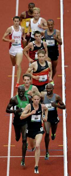 Galen Rupp leads the pack during the men's 5000 meter final at the U.S. Olympic Track and Field Tria
