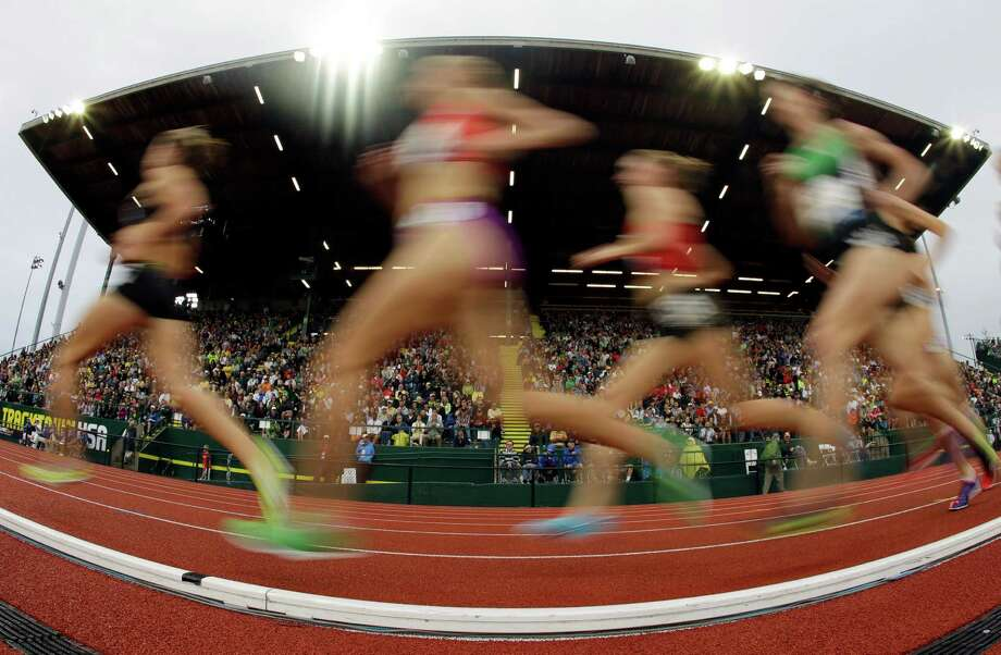 Competitors run down the straight during the women's 5000 meter final at the U.S. Olympic Track and Field Trials Thursday, June 28, 2012, in Eugene, Ore. Photo: Charlie Riedel, Associated Press / AP