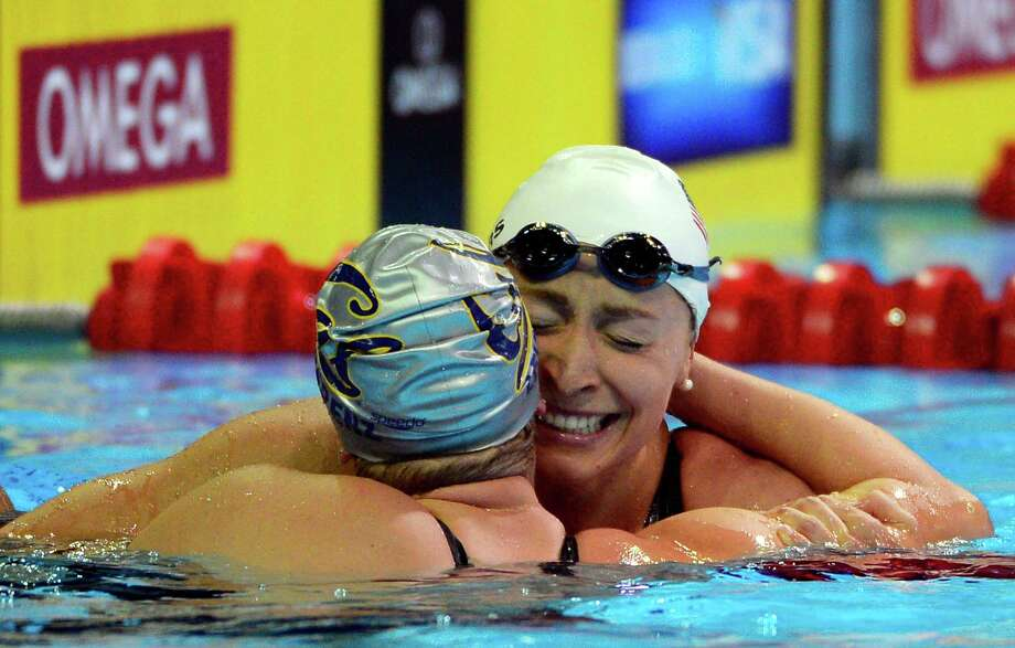 Caitlin Leverenz and Ariana Kukors, right, hug after swimming in the women's 200-meter individual medley final at the U.S. Olympic swimming trials, Thursday, June 28, 2012, in Omaha, Neb. Photo: Mark J. Terrill, Associated Press / AP