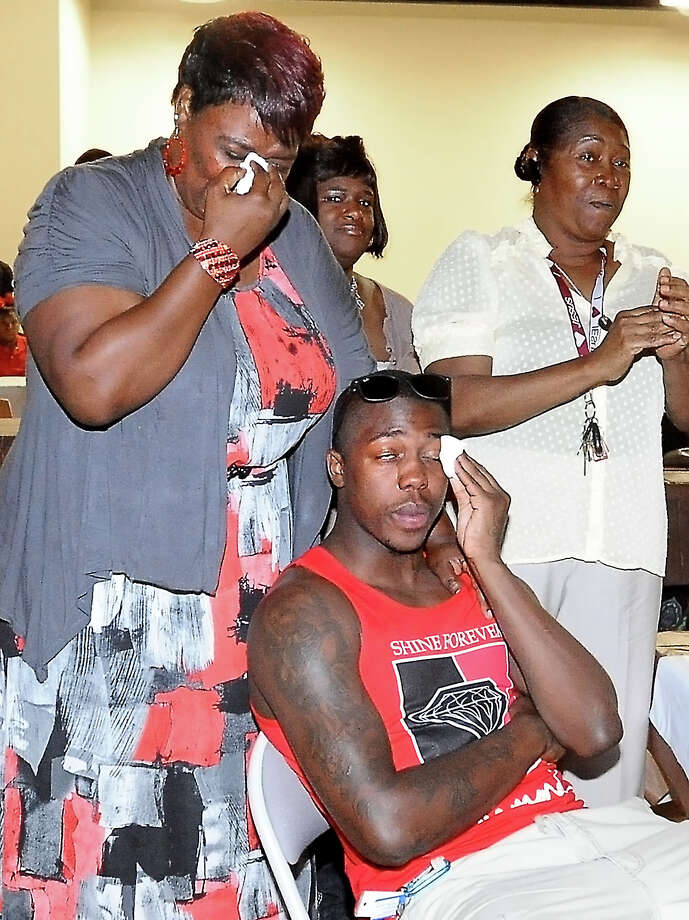 Angela Brown and her son, J'Covan Brown tear up as they watch a slide show of J'Covan life while waiting to see if he will be chosen in the NBA draft at the Recreation Center in Port Arthur, Thursday, June 28, 2012. Tammy McKinley/The Enterprise Photo: TAMMY MCKINLEY