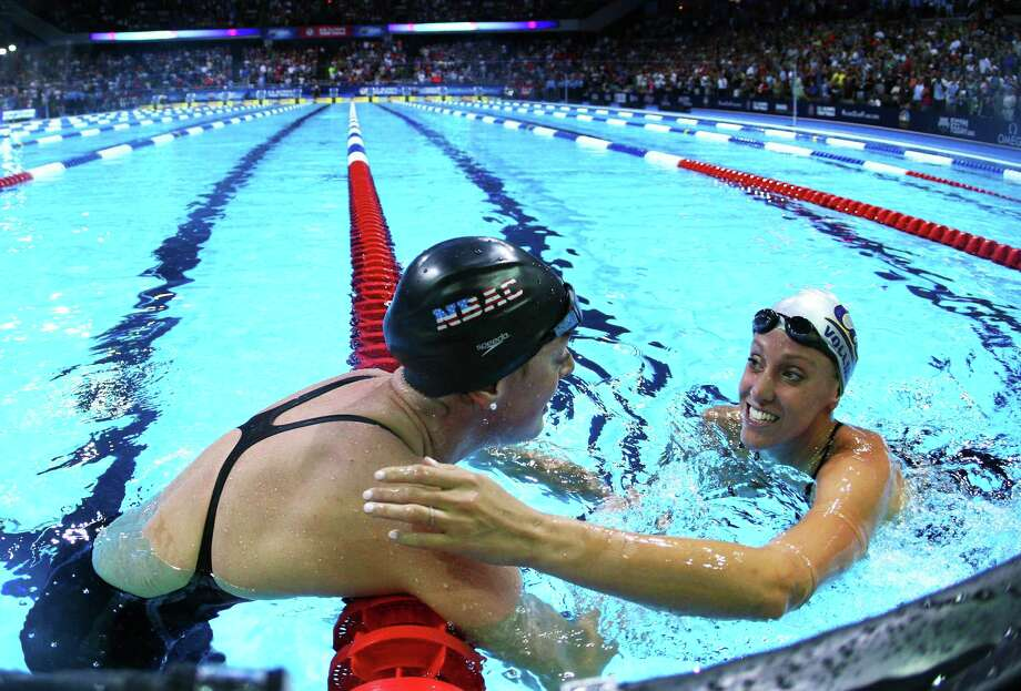 Allison Schmitt and Dana Vollmer celebrate after they competed in the championship final of the Women's 200 m Freestyle during Day Four of the 2012 U.S. Olympic Swimming Team Trials at CenturyLink Center on June 28, 2012 in Omaha, Nebraska. Photo: Jamie Squire, Getty Images / 2012 Getty Images