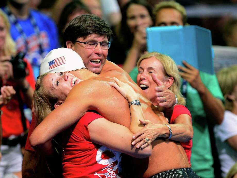Matt Grevers celebrates with his sister Carolyn, dad Ed and mom Anja  after he won the championship final of the Men's 100 m Backstroke during Day Three of the 2012 U.S. Olympic Swimming Team Trials at CenturyLink Center on June 27, 2012 in Omaha, Nebraska. Photo: Jamie Squire, Getty Images / 2012 Getty Images