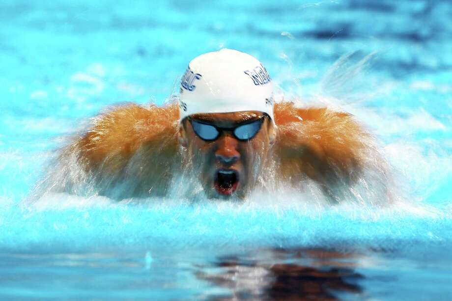 Michael Phelps competes in the second semifinal heat of the Men's 200 m Butterfly during Day Three of the 2012 U.S. Olympic Swimming Team Trials at CenturyLink Center on June 27, 2012 in Omaha, Nebraska. Photo: Al Bello, Getty Images / 2012 Getty Images