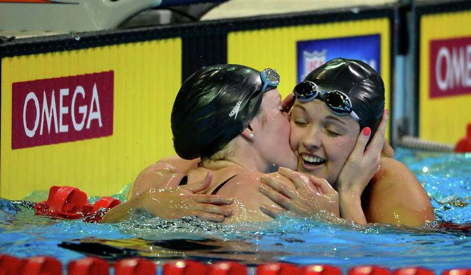 Missy Franklin, left, kisses Rachel Bootsma after winning the women's 100-meter backstroke final at the U.S. Olympic swimming trials, Wednesday, June 27, 2012, in Omaha, Neb. Photo: Mark J. Terrill, Associated Press / AP