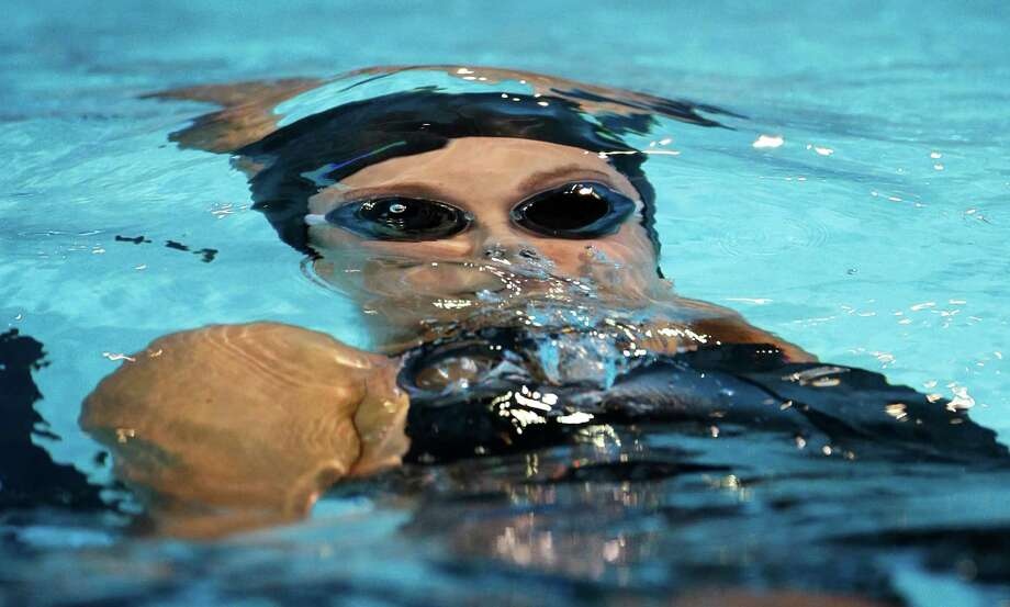 Missy Franklin swims in the women's 100-meter backstroke final at the U.S. Olympic swimming trials, Wednesday, June 27, 2012, in Omaha, Neb. Photo: Mark Humphrey, Associated Press / AP