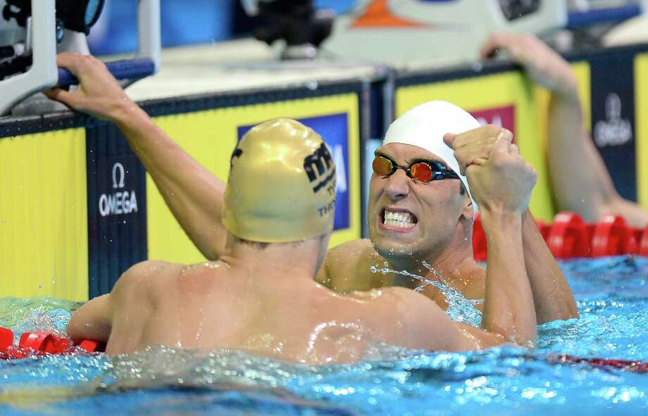 Matt Grevers  and Nick Thoman react after they competed in the championship final of the Men's 100 m Backstroke during Day Three of the 2012 U.S. Olympic Swimming Team Trials at CenturyLink Center on June 27, 2012 in Omaha, Nebraska. Photo: Jamie Squire, Getty Images / 2012 Getty Images
