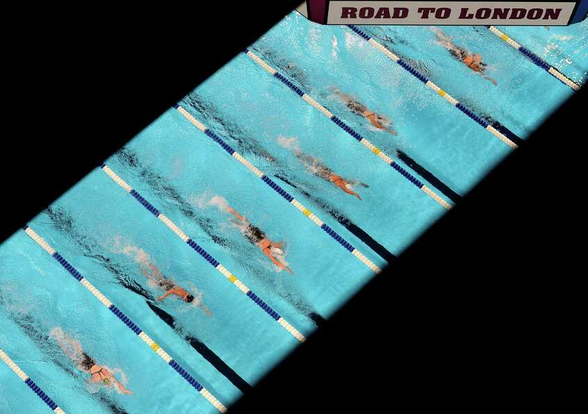 Swimmers compete in preliminary heat 10 of the Women's 400 m Freestyle during Day Two of the 2012 U.