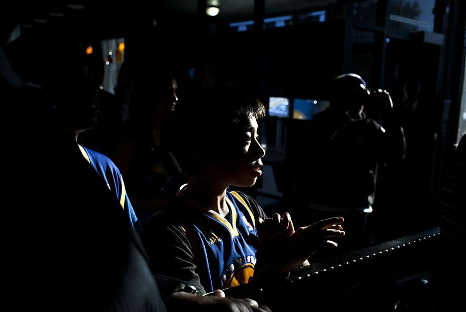 Golden State Warriors fan JC Canicose, 13, watched the 2012 NBA draft at Broadway restaurant and lounge in Oakland, Calif., Thursday, June 28, 2012. 