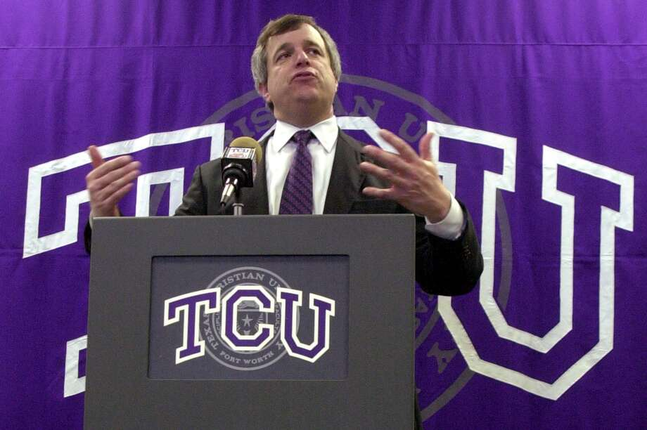 Eric Hyman speaks as Texas Christian University athletics director in 2004 as the school accepted a move to the Mountain West Conference. Photo: JESSICA KOURKOUNIS / FORT WORTH STAR-TELEGRAM