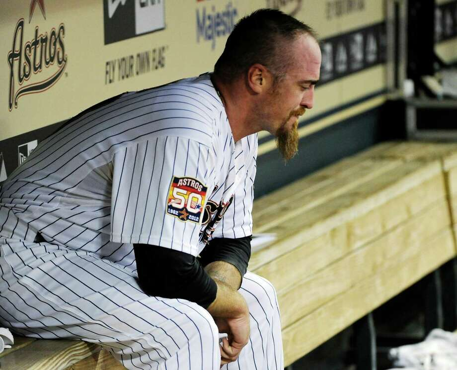 Houston Astros closer Brett Myers sits in the dugout after giving up six runs to the San Diego Padres in the ninth inning of a baseball game, Thursday, June 28, 2012, in Houston. The Padres won 7-3. Photo: AP
