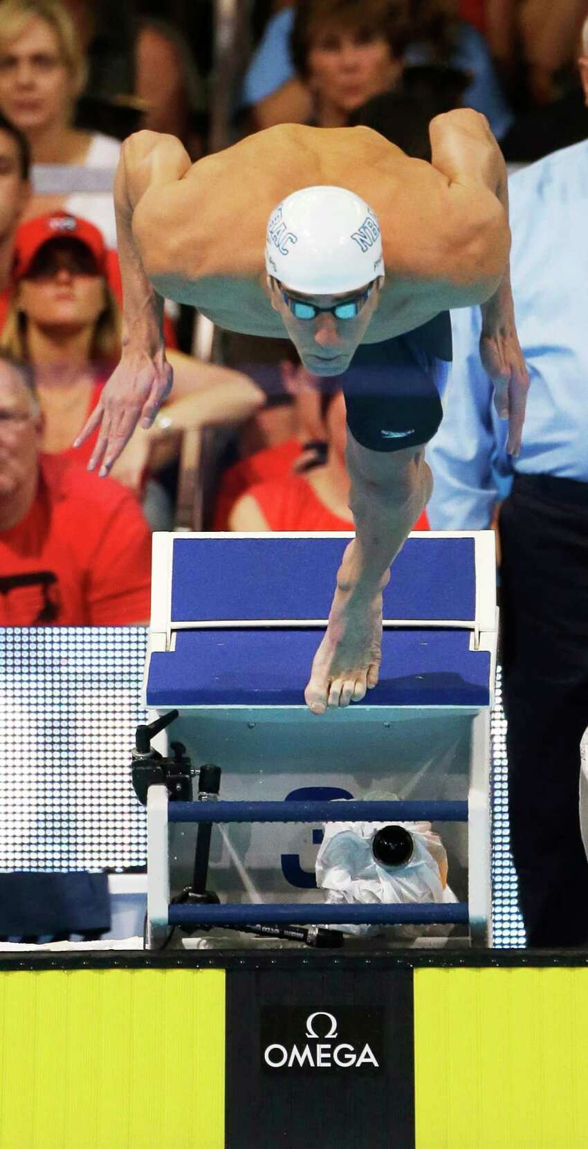 Michael Phelps dives at the start of the men's 200-meter butterfly final at the U.S. Olympic swimming trials on Thursday, June 28, 2012, in Omaha, Neb. Phelps won the final. (AP Photo/Mark Humphrey)