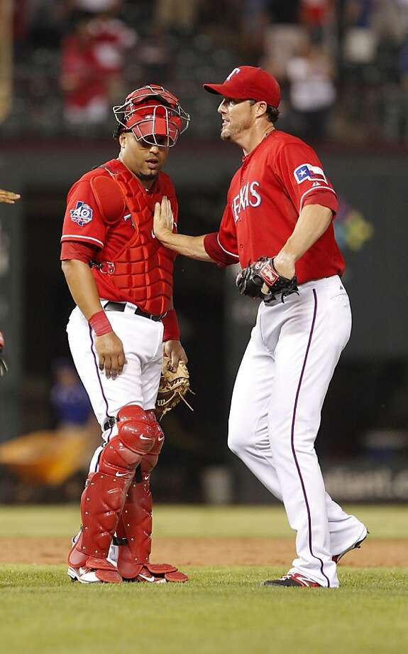 Texas Rangers pitcher Joe Nathan and catcher Yorvit Torrealba following a baseball game against the Oakland Athletics Thursday, June 28, 2012, in Arlington, Texas.  (AP Photo/Tim Sharp) Photo: Tim Sharp, Associated Press
