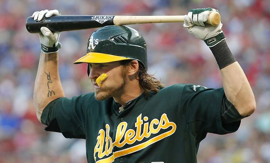Oakland Athletics' Josh Reddick reacts as he walks back to the dugout after popping out against the Texas Rangers in the third inning of a baseball game Thursday, June 28, 2012, in Arlington, Texas. (AP Photo/Tim Sharp) Photo: Tim Sharp, Associated Press