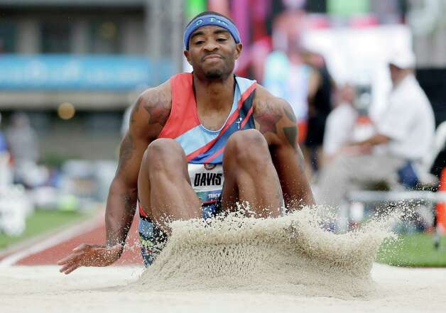 Walter Davis lands during the triple jump qualifying at the U.S. Olympic Track and Field Trials Thursday, June 28, 2012, in Eugene, Ore. Davis placed fourth. (AP Photo/Matt Slocum) Photo: Associated Press