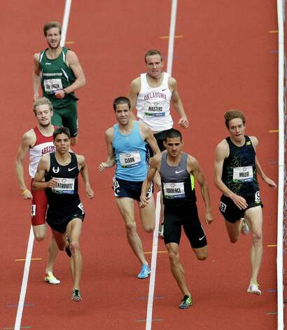 The athletes competes in the first heat of the men�s 1500 meters qualifying round at the U.S. Olympic Track and Field Trials Thursday, June 28, 2012, in Eugene, Ore. Craig Miller, far right, David Torrence, center, and Matthew Centrowitz, left, finished first, second and third.  (AP Photo/Marcio Jose Sanchez) Photo: Associated Press
