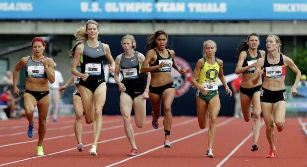 Anna Pierce, from left, Alice Schmidt and Amy Mortimer lead the pack down the stretch during the women's 1500 meter qualifying at the U.S. Olympic Track and Field Trials Thursday, June 28, 2012, in Eugene, Ore. (AP Photo/Eric Gay) Photo: Associated Press