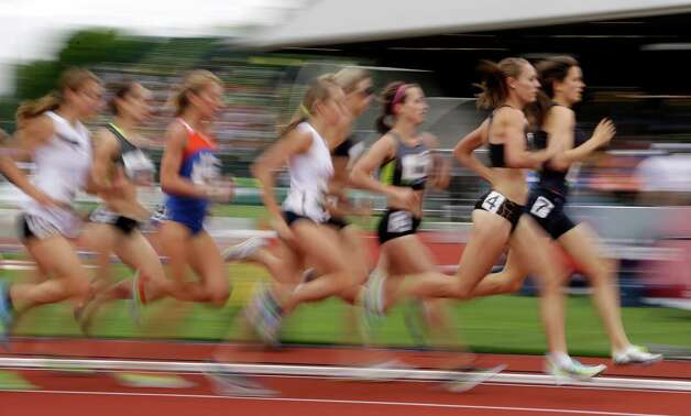 Lauren Bonds (7) and Morgan Uceny (4) lead the pack during the women's 1500 meter qualifying at the U.S. Olympic Track and Field Trials Thursday, June 28, 2012, in Eugene, Ore. (AP Photo/Eric Gay) Photo: Associated Press