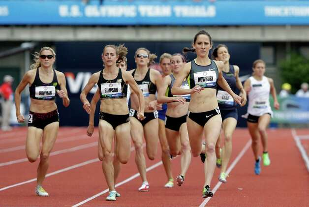 Shannon Rowbury leads the pack down the stretch during the women's 1500 meter qualifying at the U.S. Olympic Track and Field Trials Thursday, June 28, 2012, in Eugene, Ore. (AP Photo/Eric Gay) Photo: Associated Press