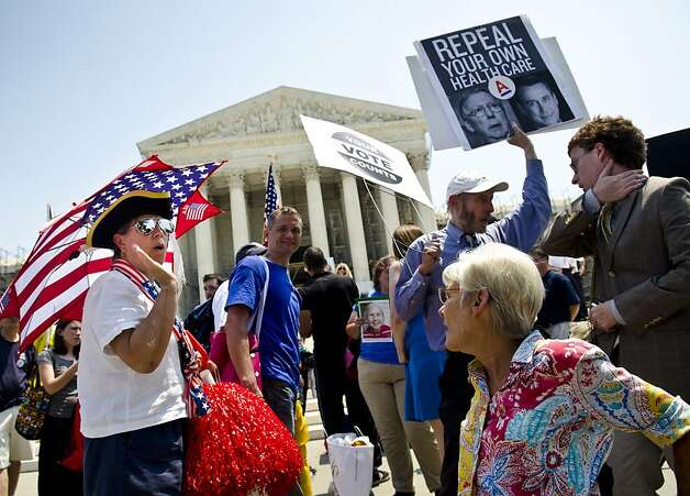 WASHINGTON, DC - JUNE 28:  Protestors argue about the Affordable Healthcare Act outside the U.S. Supreme Court on June 28, 2012 in Washington, DC. The Court found the law to be constitutional and did not strike down any part of it. (Photo by Kris Connor/Getty Images) Photo: Kris Connor, Getty Images