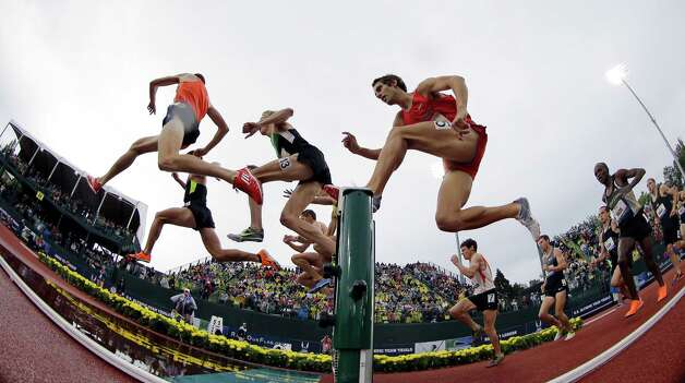 Daniel Huling (3) leaps during the men's 3000 meter steeplechase finals at the U.S. Olympic Track and Field Trials Thursday, June 28, 2012, in Eugene, Ore. (AP Photo/Matt Slocum) Photo: Associated Press