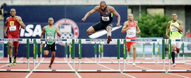 Angelo Taylor leads during the men's 400 meter hurdles qualifying at the U.S. Olympic Track and Field Trials Thursday, June 28, 2012, in Eugene, Ore. (AP Photo/Eric Gay) Photo: Associated Press