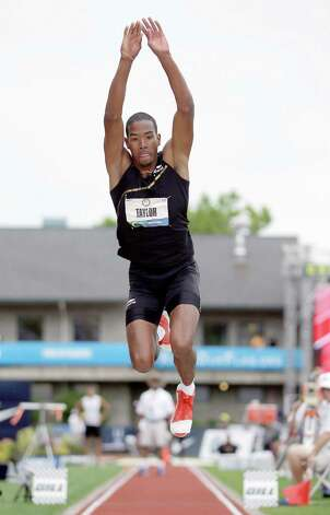 Christian Taylor competes in triple jump qualifying at the U.S. Olympic Track and Field Trials Thursday, June 28, 2012, in Eugene, Ore. Taylor took first place. (AP Photo/Matt Slocum) Photo: Associated Press