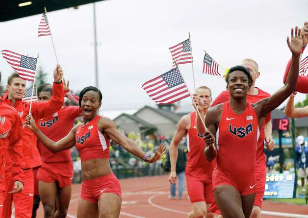 The new U.S. Olympic uniforms are debuted at the U.S. Olympic Track and Field Trials Thursday, June 28, 2012, in Eugene, Ore. (AP Photo/Marcio Jose Sanchez) Photo: Associated Press