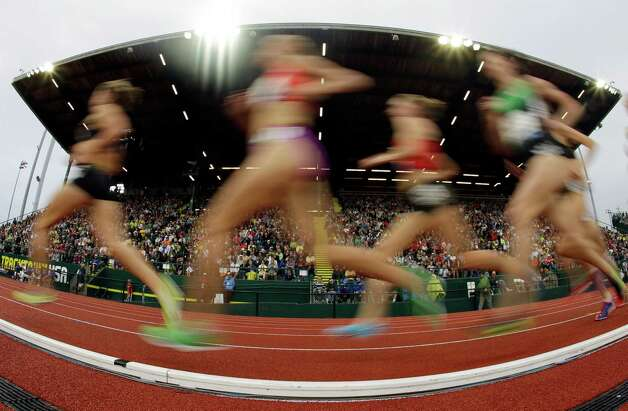 Competitors run down the straight during the women's 5000 meter final at the U.S. Olympic Track and Field Trials Thursday, June 28, 2012, in Eugene, Ore. (AP Photo/Charlie Riedel) Photo: Associated Press