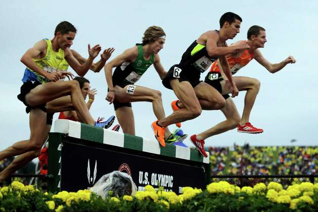 Benjamin Bruce, from right, Donald Cabral, Evan Jager and Brian Olinger leap at the water jump during the men's 3000 meter steeplechase final at the U.S. Olympic Track and Field Trials Thursday, June 28, 2012, in Eugene, Ore. (AP Photo/Matt Slocum) Photo: Associated Press