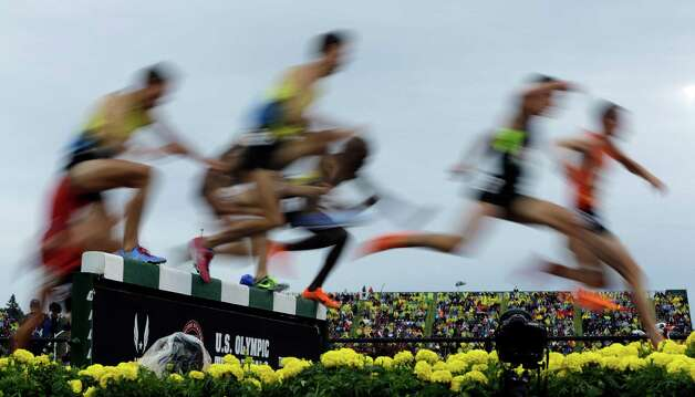 Runners leap at the water jump during the men's 3000 meter steeplechase final at the U.S. Olympic Track and Field Trials Thursday, June 28, 2012, in Eugene, Ore. (AP Photo/Matt Slocum) Photo: Associated Press