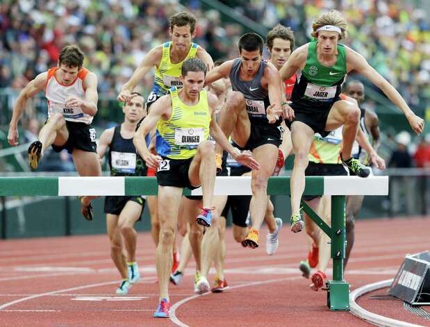 Evan Jager, front, right, competes alongside, Donald Cabral, center, and Brian Olinger, left, during the men's 3000 meter steeplechase at the U.S. Olympic Track and Field Trials Thursday, June 28, 2012, in Eugene, Ore. Jager placed first.  (AP Photo/Eric Gay) Photo: Associated Press