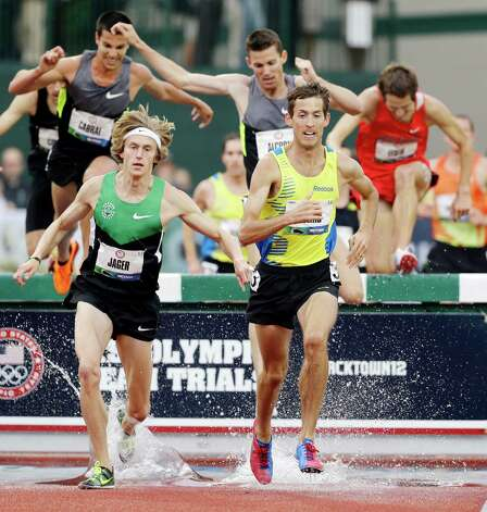 Evan Jager, left, and Daniel Huling compete in the men's 3000 meter steeplechase at the U.S. Olympic Track and Field Trials Thursday, June 28, 2012, in Eugene, Ore. Jager on the race. (AP Photo/Marcio Jose Sanchez) Photo: Associated Press