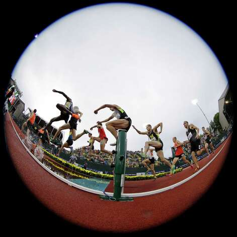 Kyle Alcorn leaps at the water jump during the men's 3000 meter steeplechase finals at the U.S. Olympic Track and Field Trials Thursday, June 28, 2012, in Eugene, Ore. (AP Photo/Matt Slocum) Photo: Associated Press