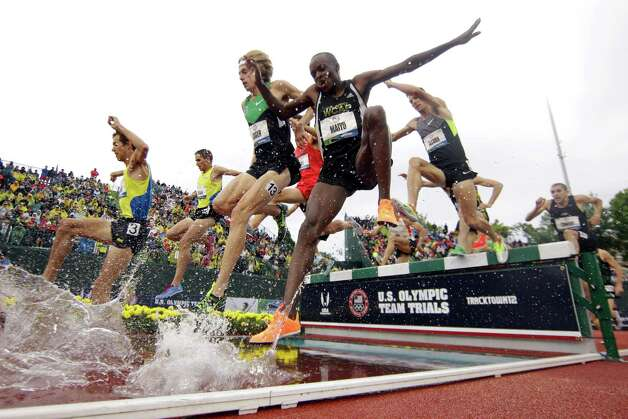 Augustus Maiyo and Evan Jager land in the water jump during the men's 3000 meter steeplechase finals at the U.S. Olympic Track and Field Trials Thursday, June 28, 2012, in Eugene, Ore. (AP Photo/Matt Slocum) Photo: Associated Press