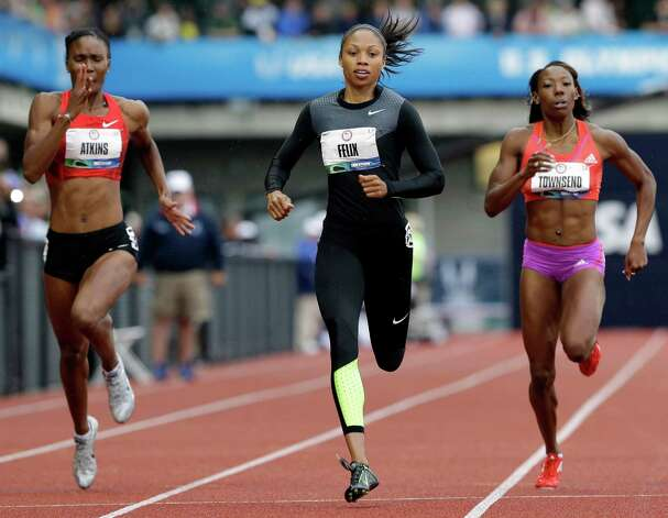 Allyson Felix finishes her heat in the women's 200 meters at the U.S. Olympic Track and Field Trials Thursday, June 28, 2012, in Eugene, Ore ahead of Joanna Atkins, left, and Tiffany Townsend. (AP Photo/Eric Gay) Photo: Associated Press