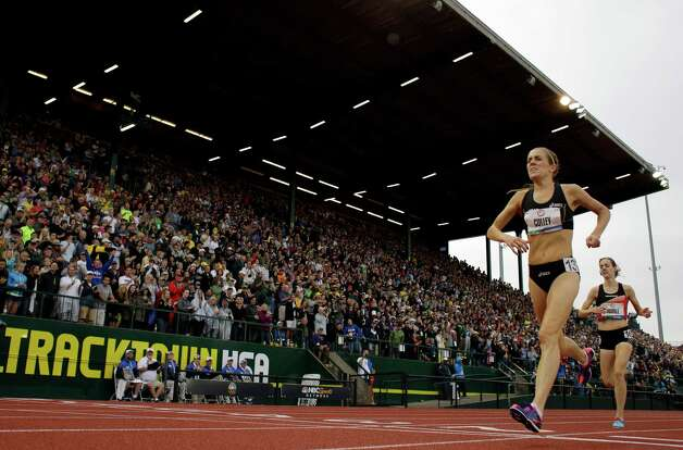 Julie Culley and Molly Huddle race to the finish line during the women's 5000 meter final at the U.S. Olympic Track and Field Trials Thursday, June 28, 2012, in Eugene, Ore. (AP Photo/Matt Slocum) Photo: Associated Press