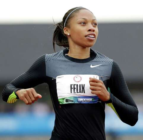 Allyson Felix finishes her heat in the women's 200 meters at the U.S. Olympic Track and Field Trials Thursday, June 28, 2012, in Eugene, Ore. (AP Photo/Eric Gay) Photo: Associated Press