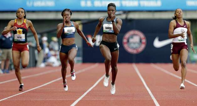 Jeneba Tarmoh finishes first in her heat in the women's 200 meters at the U.S. Olympic Track and Field Trials Thursday, June 28, 2012, in Eugene, Ore. Also racing are Aareon Payne, left, Shareese Woods, second from left, and Ashley Collier.  (AP Photo/Eric Gay) Photo: Associated Press