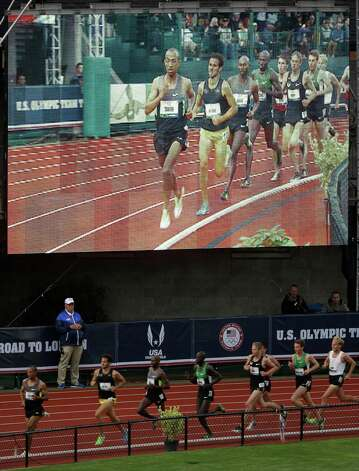 Runners compete in the men's 5000 meter final at the U.S. Olympic Track and Field Trials Thursday, June 28, 2012, in Eugene, Ore. (AP Photo/Charlie Riedel) Photo: Associated Press